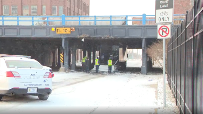 Truck gets stuck under bridge on Lafayette St, what officials call a