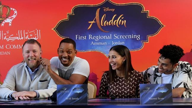 a0727e00b Actor Will Smith, second right, director Guy Ritchie, left, and cast  members Naomi Scott, second right, and Mena Massoud, give a news conference  for the ...